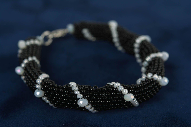 Handmade beaded cord wrist bracelet of white and black colors for women photo 3