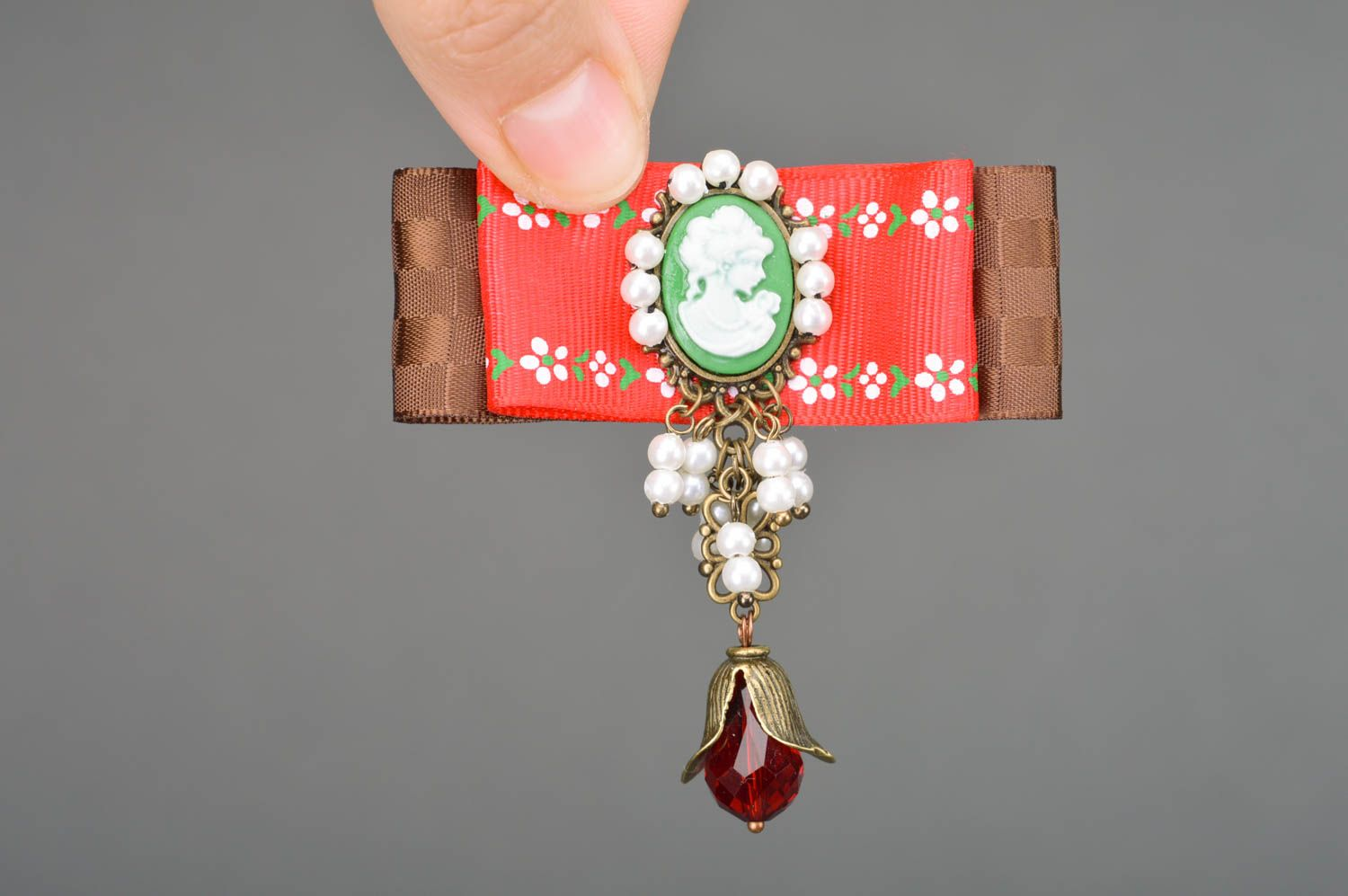 cameo brooches Handmade vintage rep ribbon brooch with cameo and beads in red and brown colors - MADEheart.com