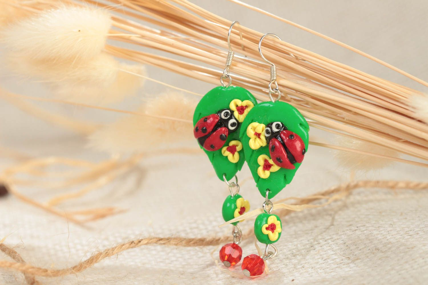 Handmade bright green long dangling polymer clay earrings with ladybugs photo 1