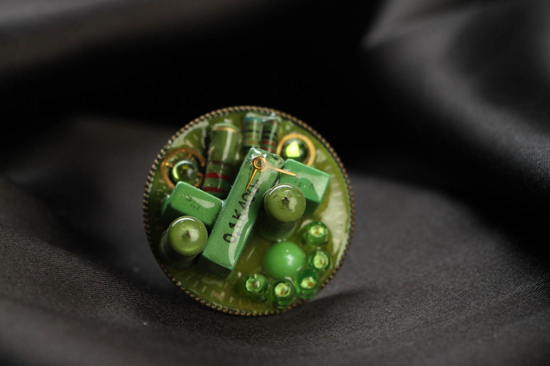 Green metal ring in cyberpunk style photo 2