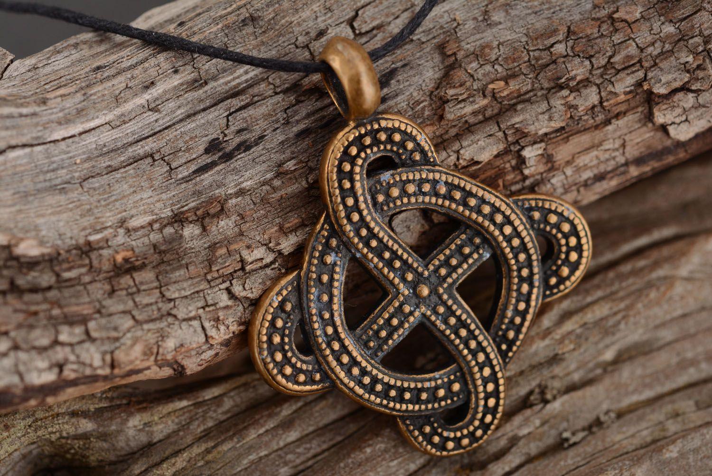 Bronze pendant with solar symbol photo 2