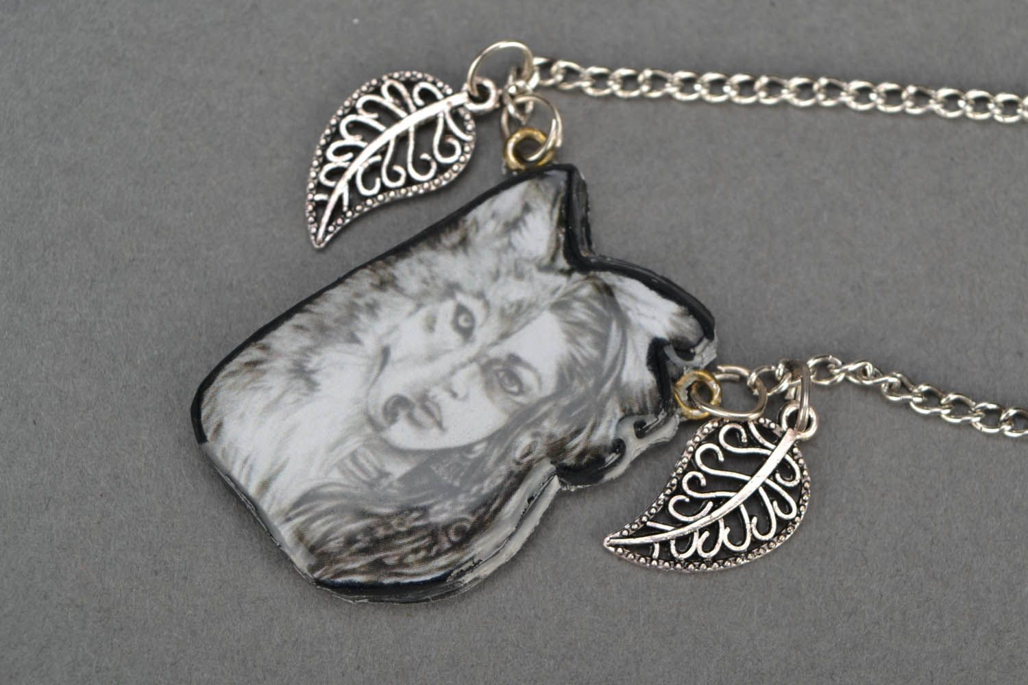 Pendant on a long metal chain photo 4