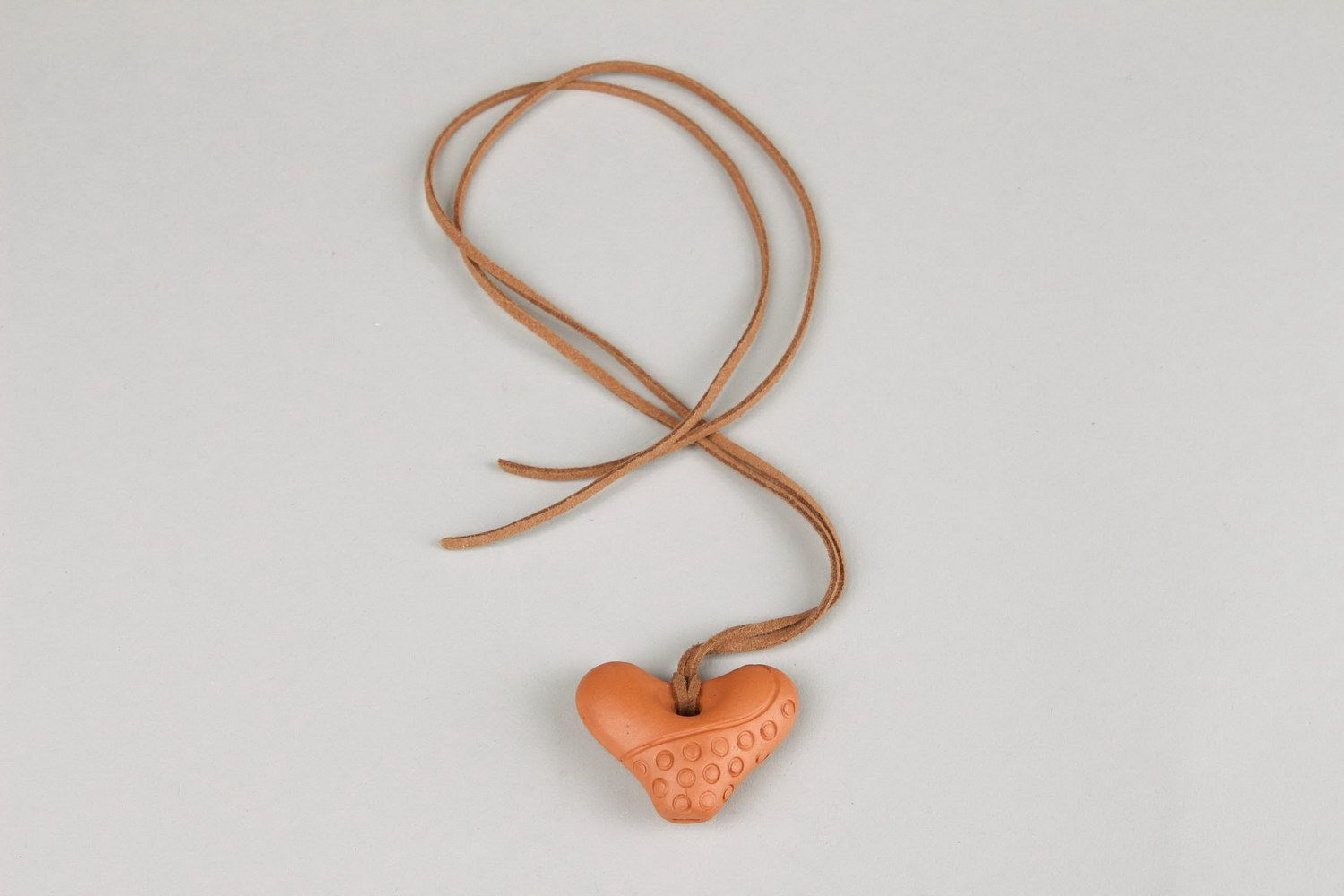 Heart-shaped tin whistle pendant made of clay  photo 5