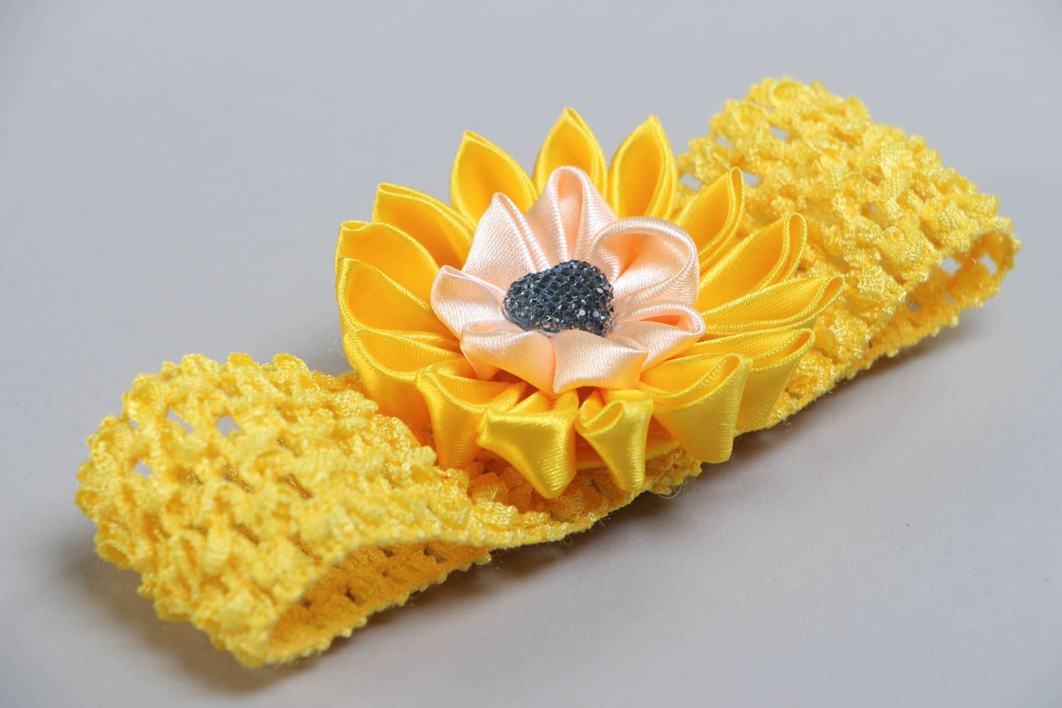 Handmade yellow headband with elastic lacy basis and satin ribbon flower photo 3