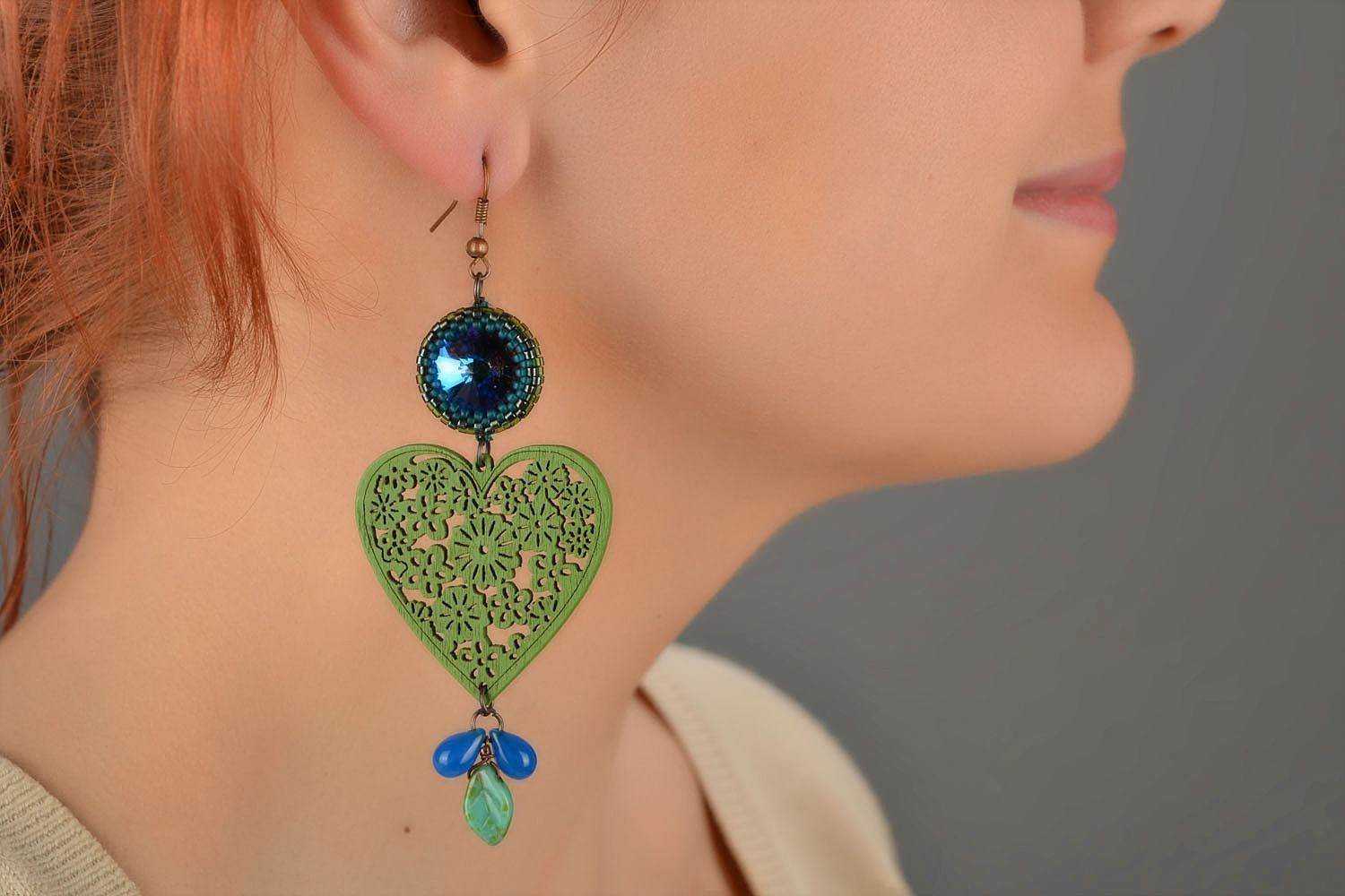 Handmade long designer earrings with wooden green hearts and Czech glass photo 1