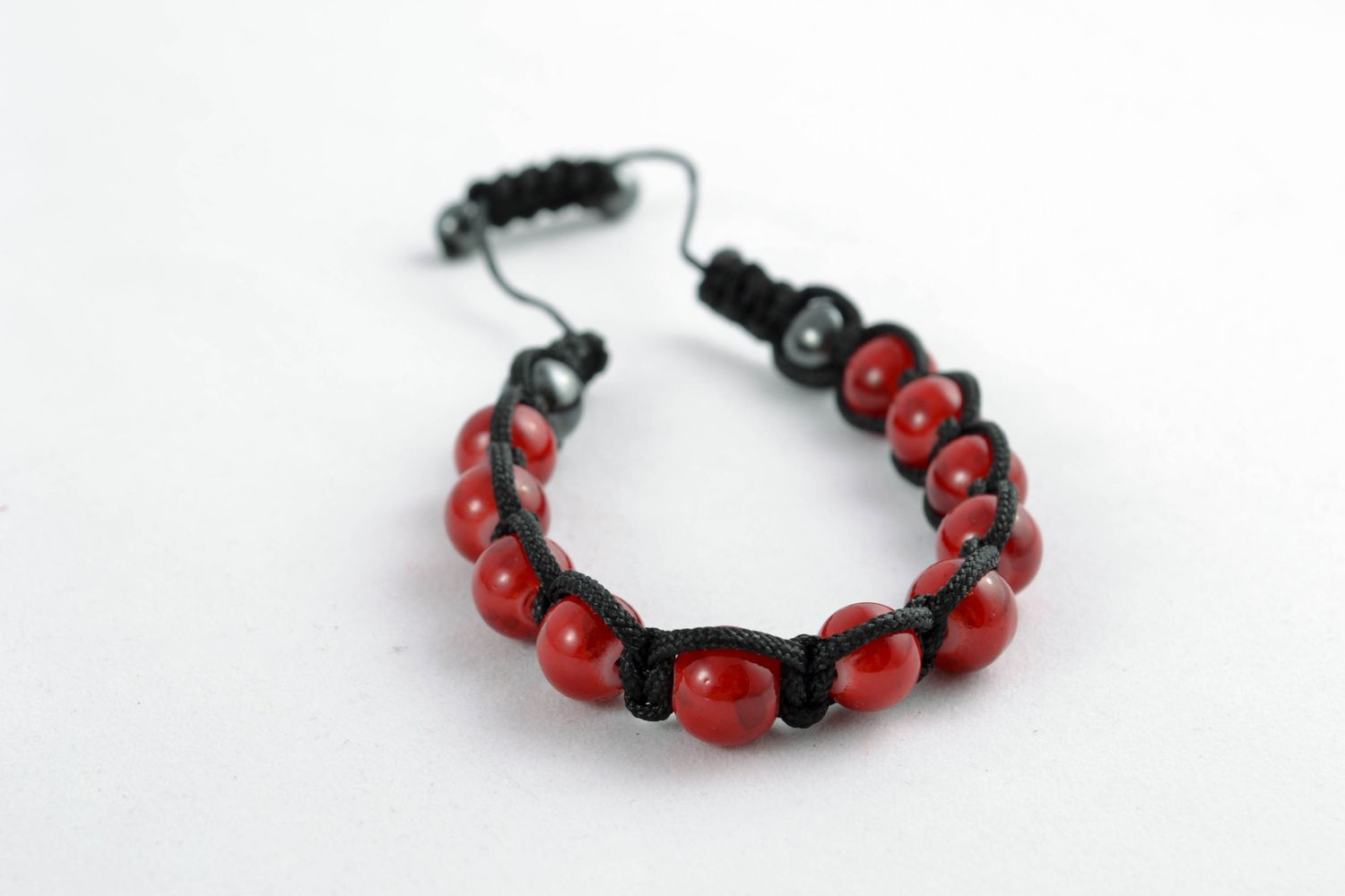 Cord bracelet with red beads photo 3