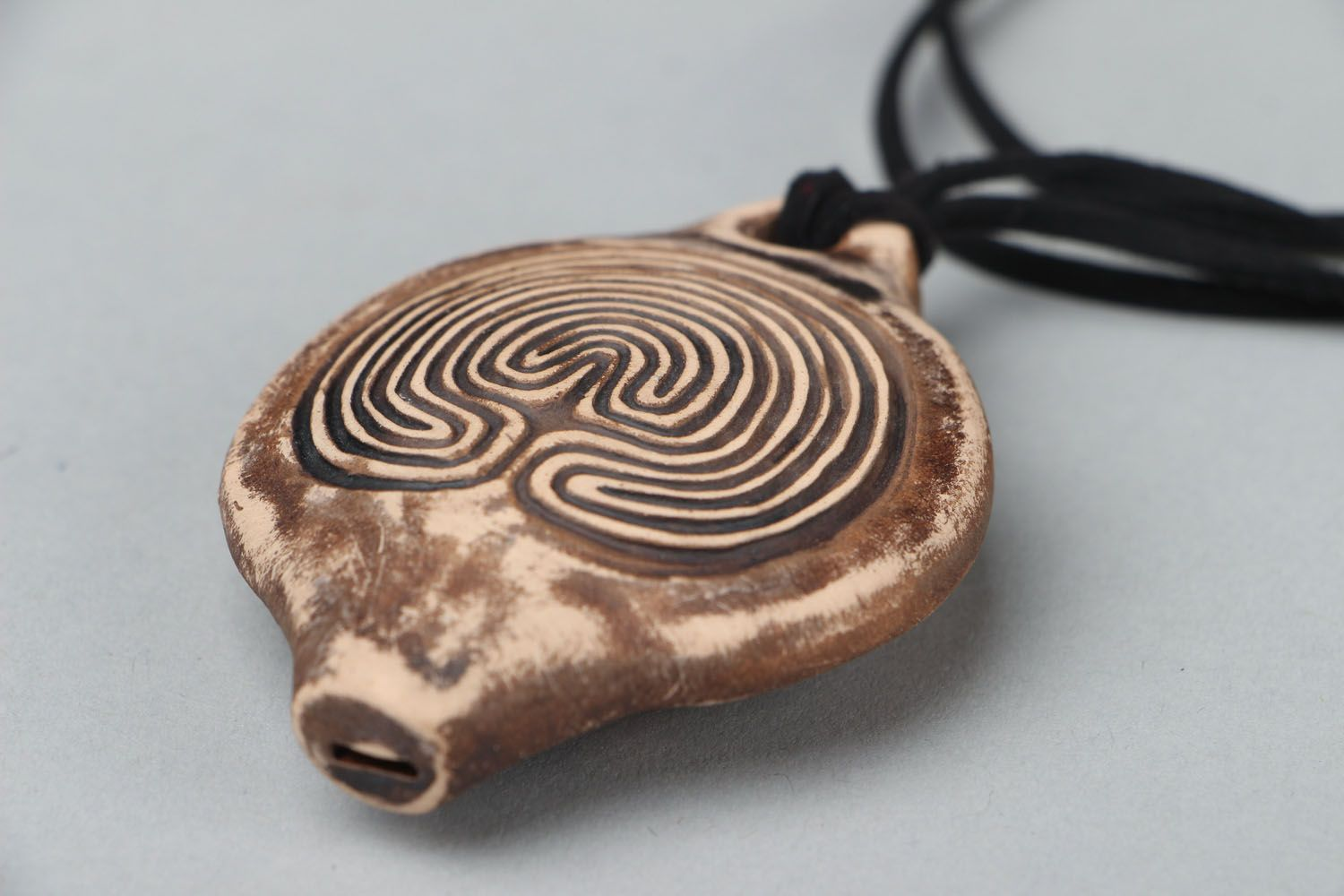 Unusual clay penny whistle with a cord photo 2