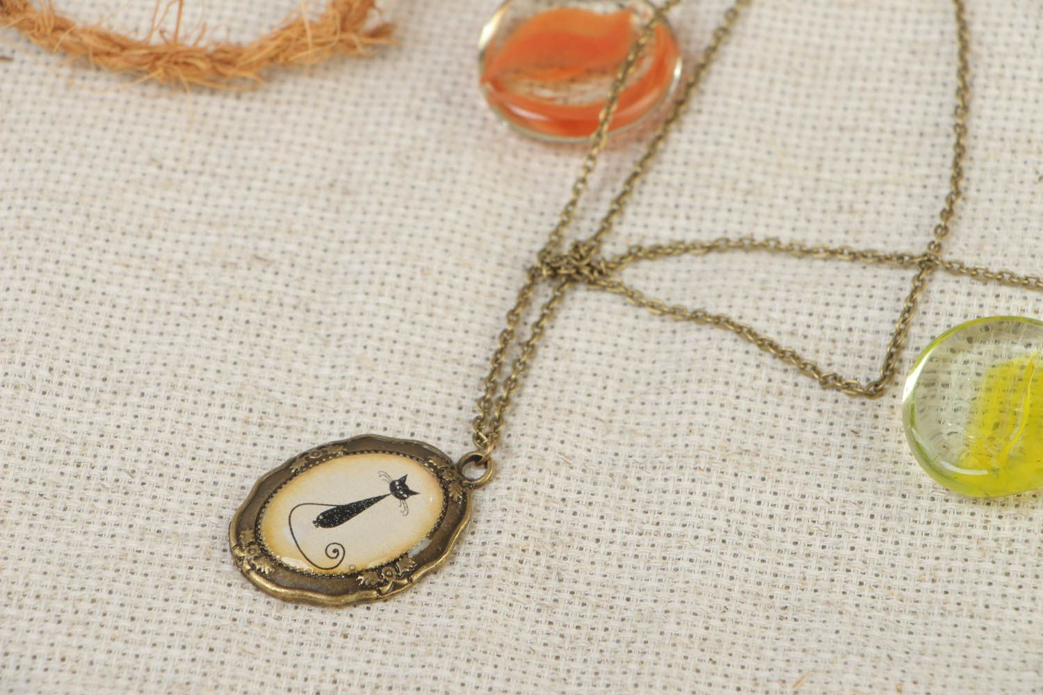 Handmade vintage metal oval necklace with cat image coated with glass glaze photo 1