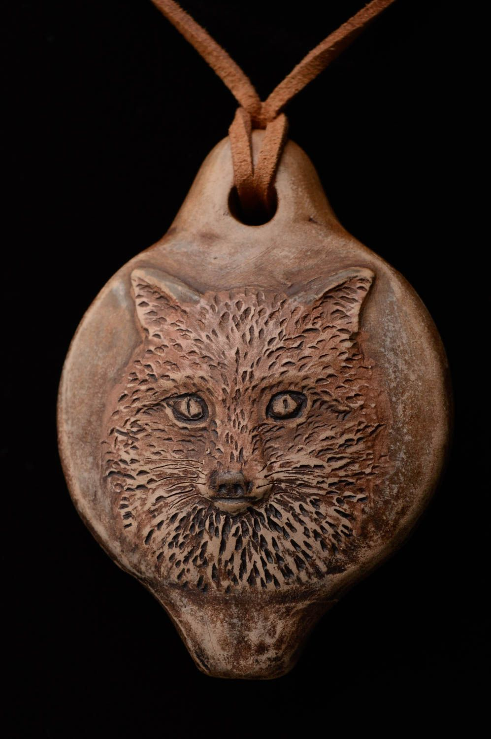 Clay pendant penny whistle Wolf photo 1