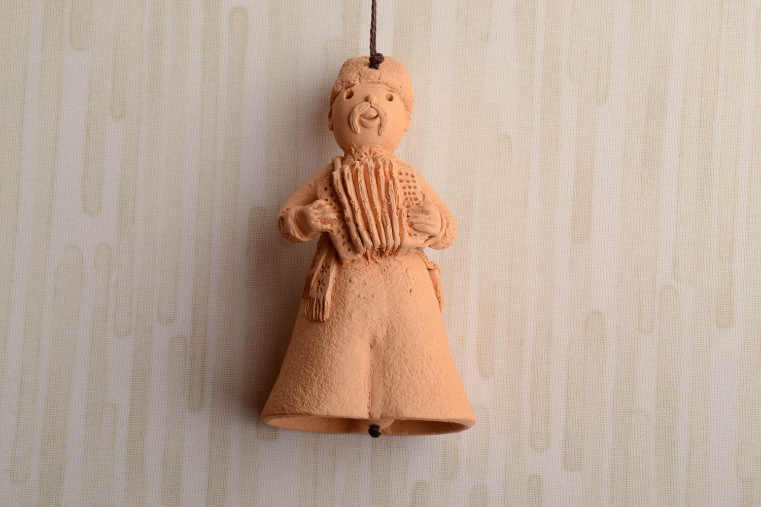 Handmade clay bell in the shape of accordion player photo 1