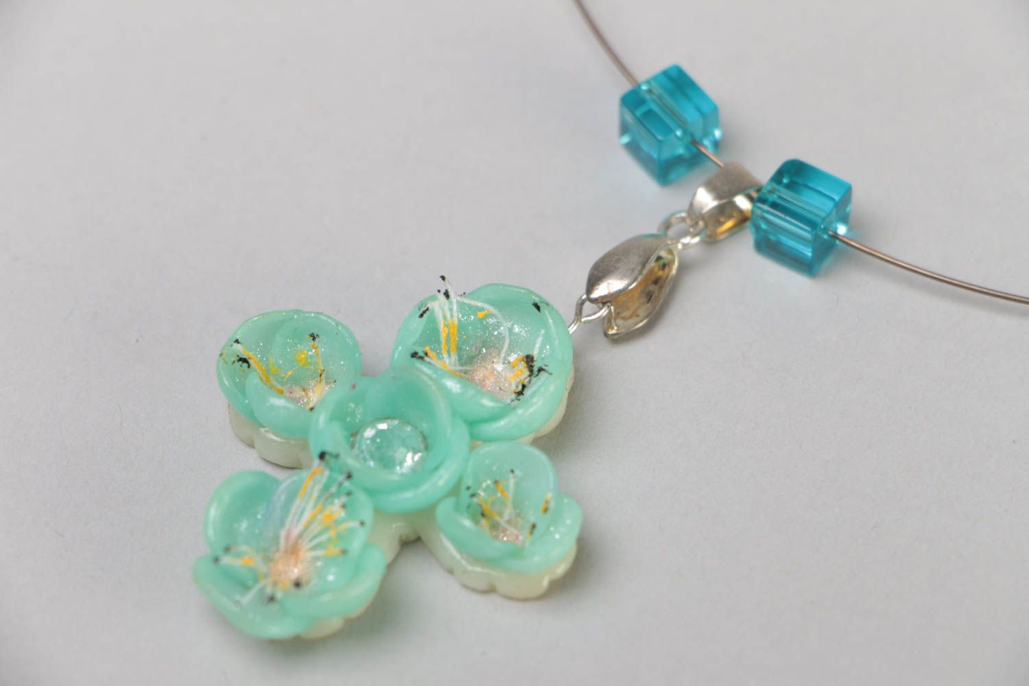 Handmade necklace on metal wire with polymer clay cross pendant of blue color photo 3