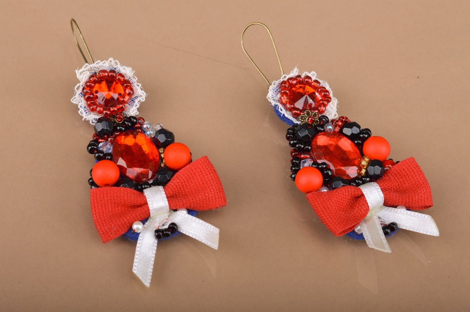 Handmade festive beaded dangle earrings with bows in red color palette for women photo 1