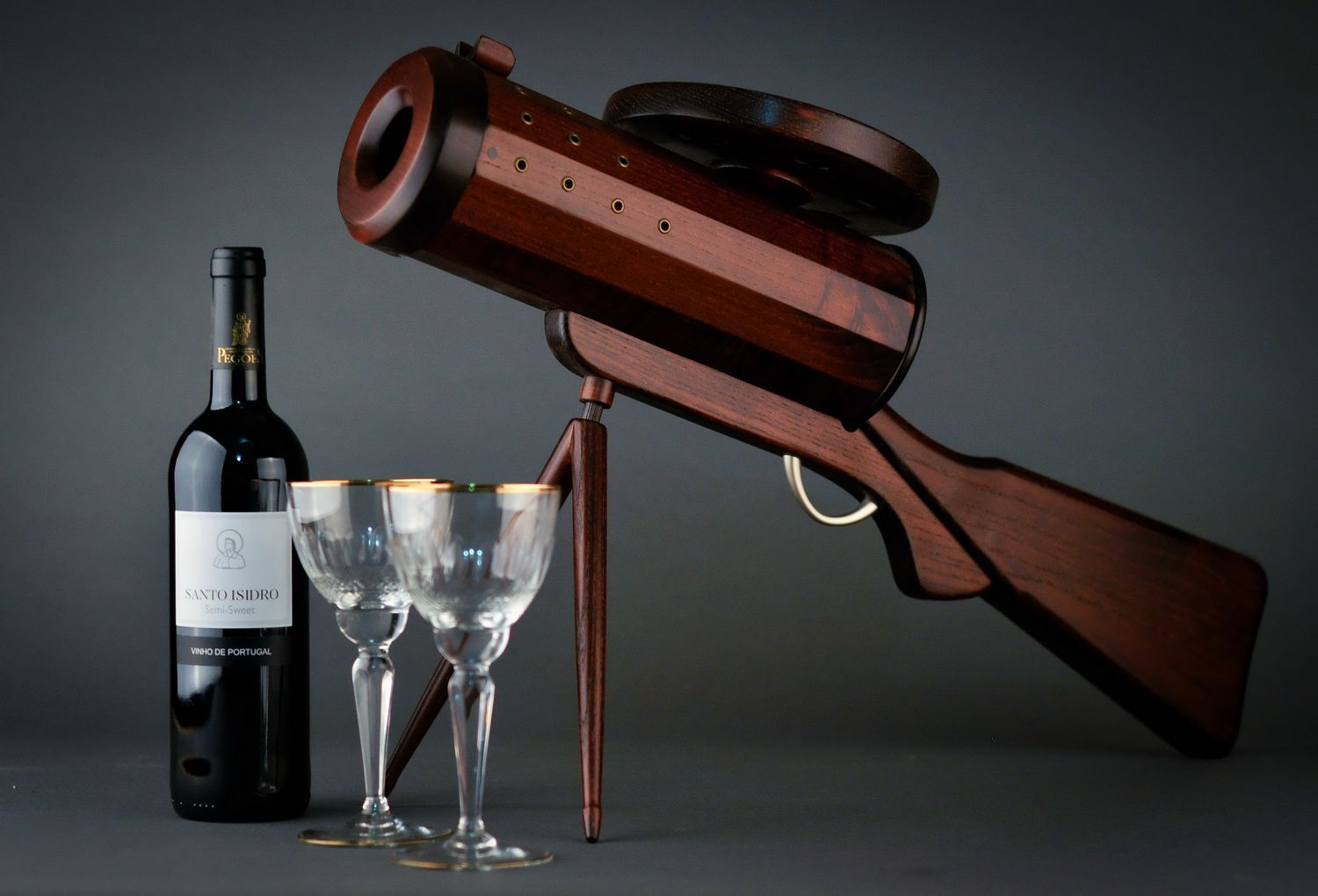 Wooden wine bottle stand in the form of a gun photo 1