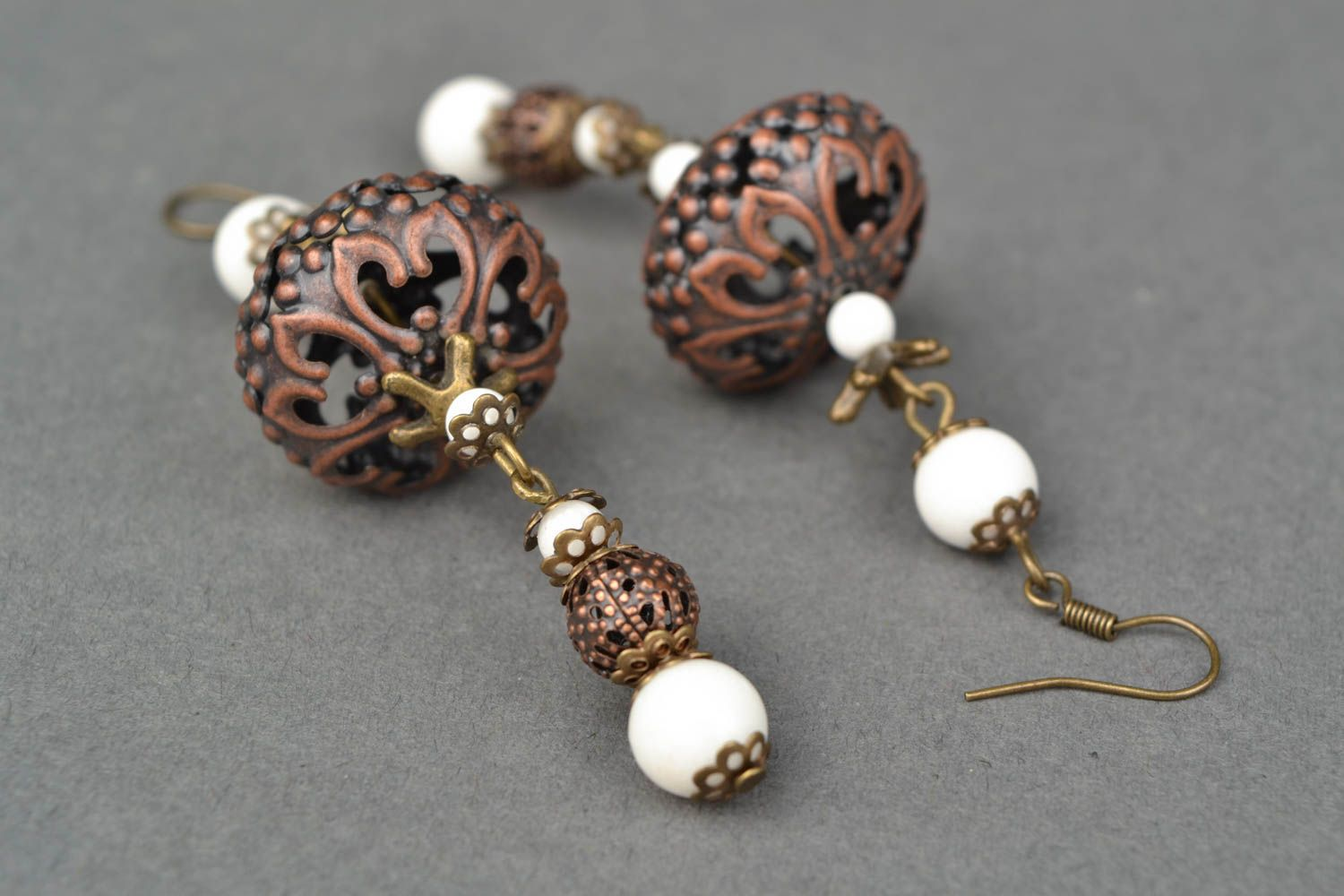 Metal earrings with ceramic beads photo 4