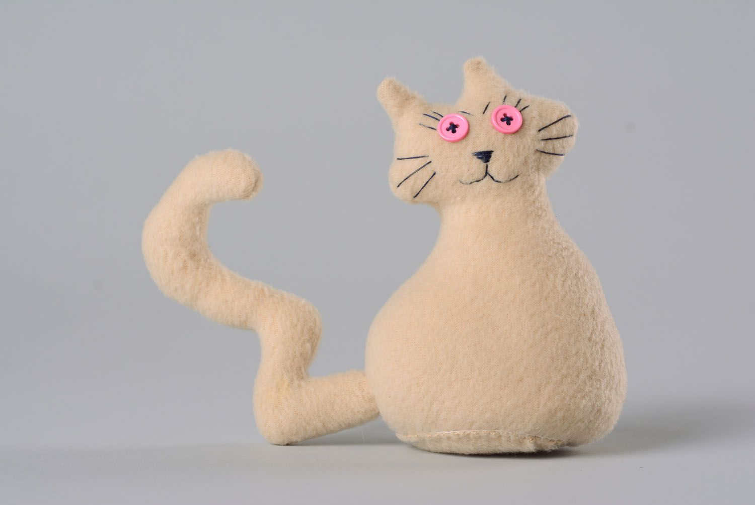 Soft toy in the shape of cat photo 1