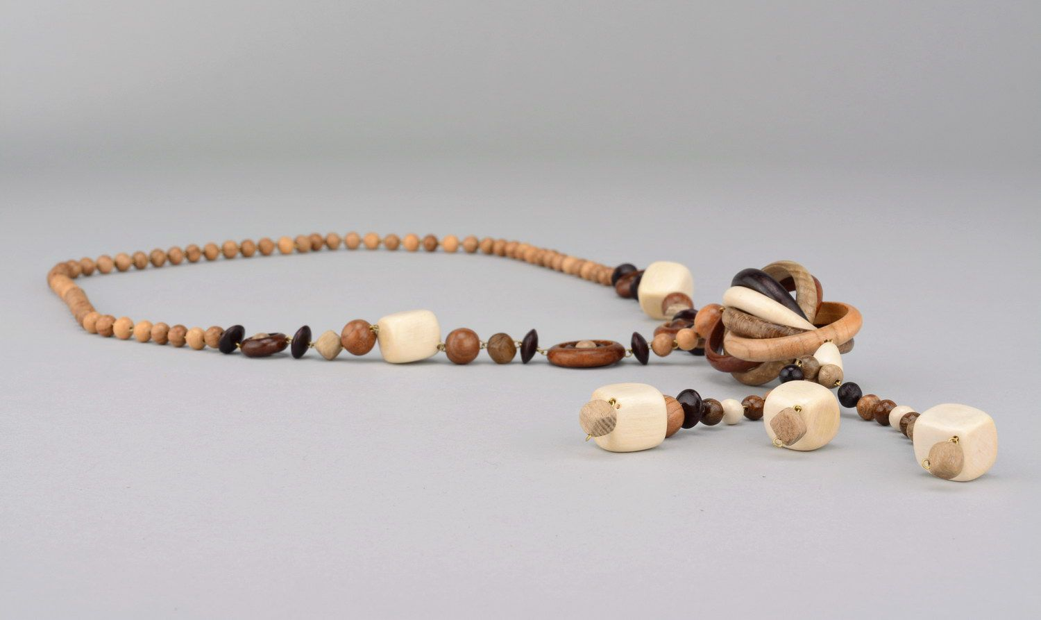 Long beads made of different wood species without clasps photo 2