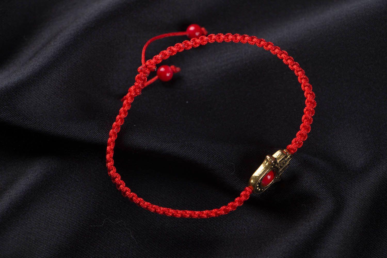 Woven bracelet with hamsa photo 1