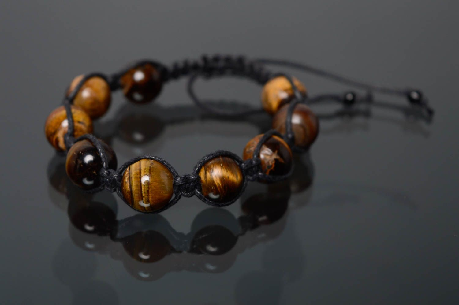 Woven bracelet with natural stone photo 1