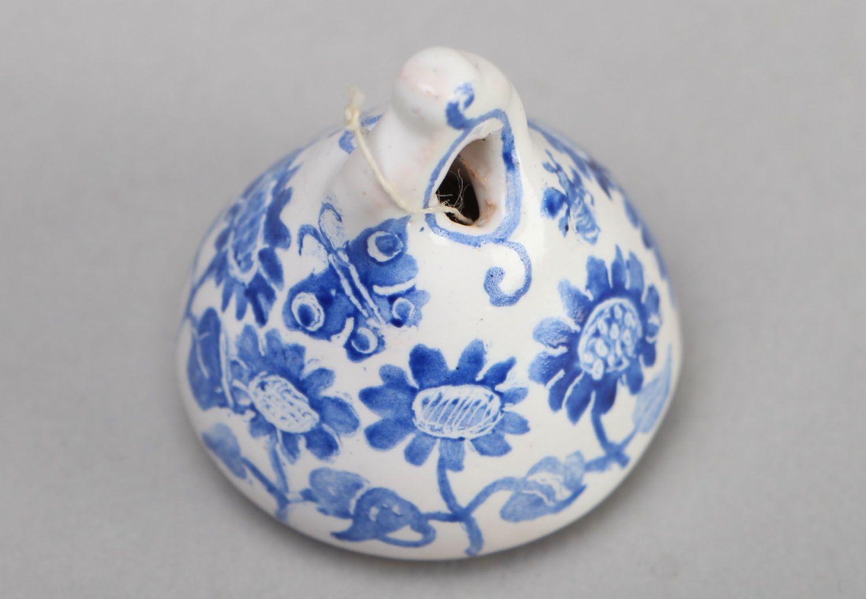 Ceramic bell kilned in a furnace photo 2
