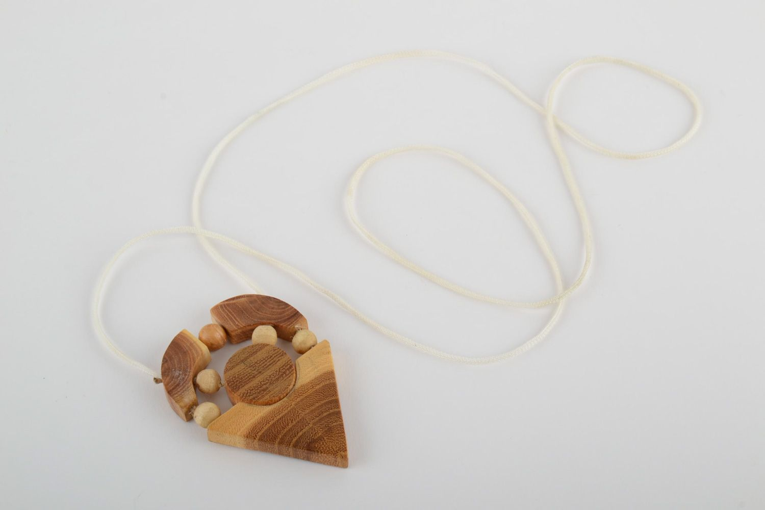 Handmade geometric neck pendant carved of wood and varnished on cord for ladies photo 4