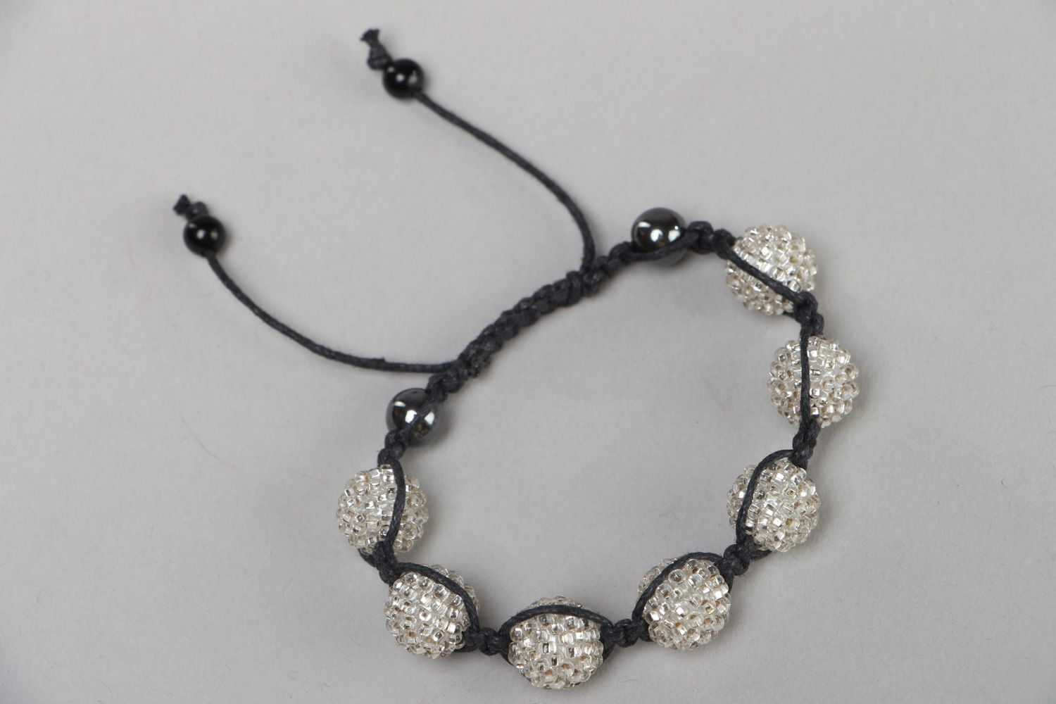 Handmade black and white friendship bracelet woven of waxed cord and beads  photo 2