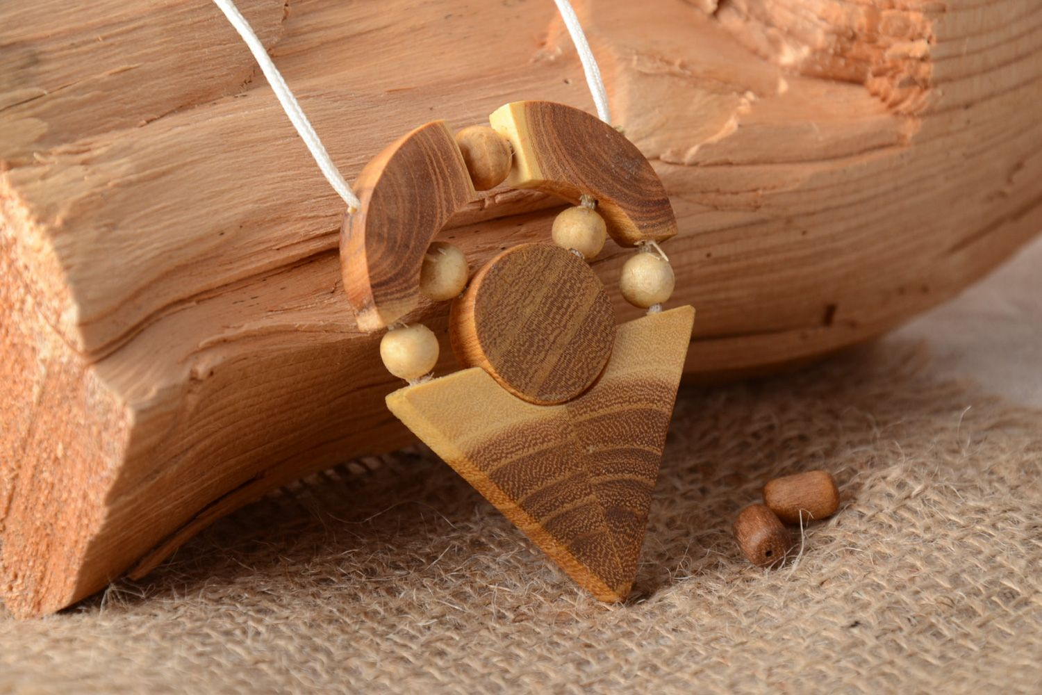 Handmade geometric neck pendant carved of wood and varnished on cord for ladies photo 1