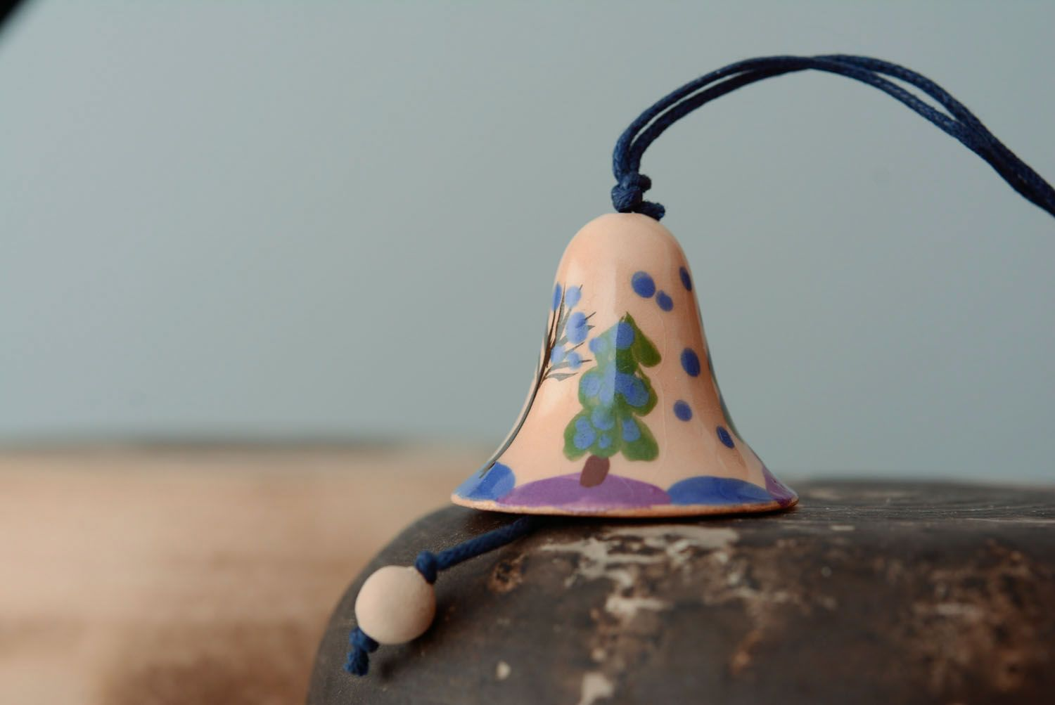 Small ceramic bell with a cord photo 1