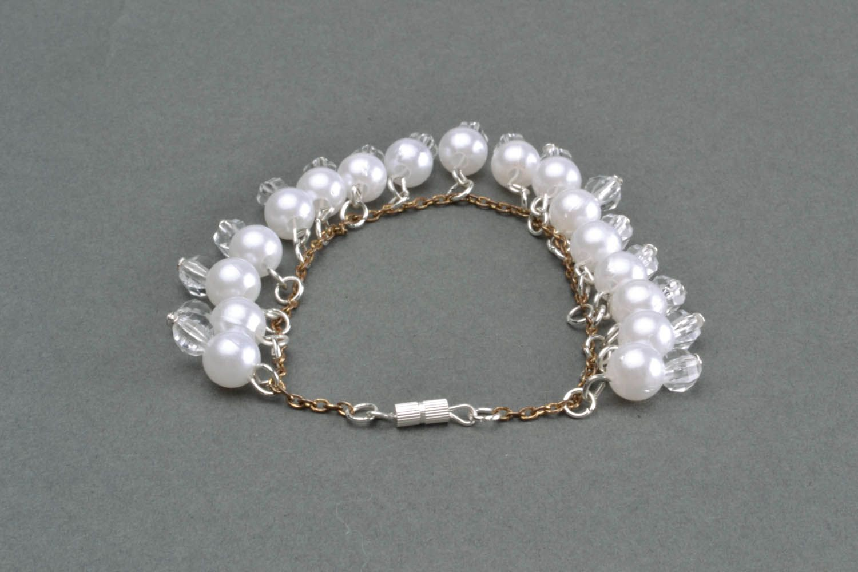 Bracelet made of white beads photo 4