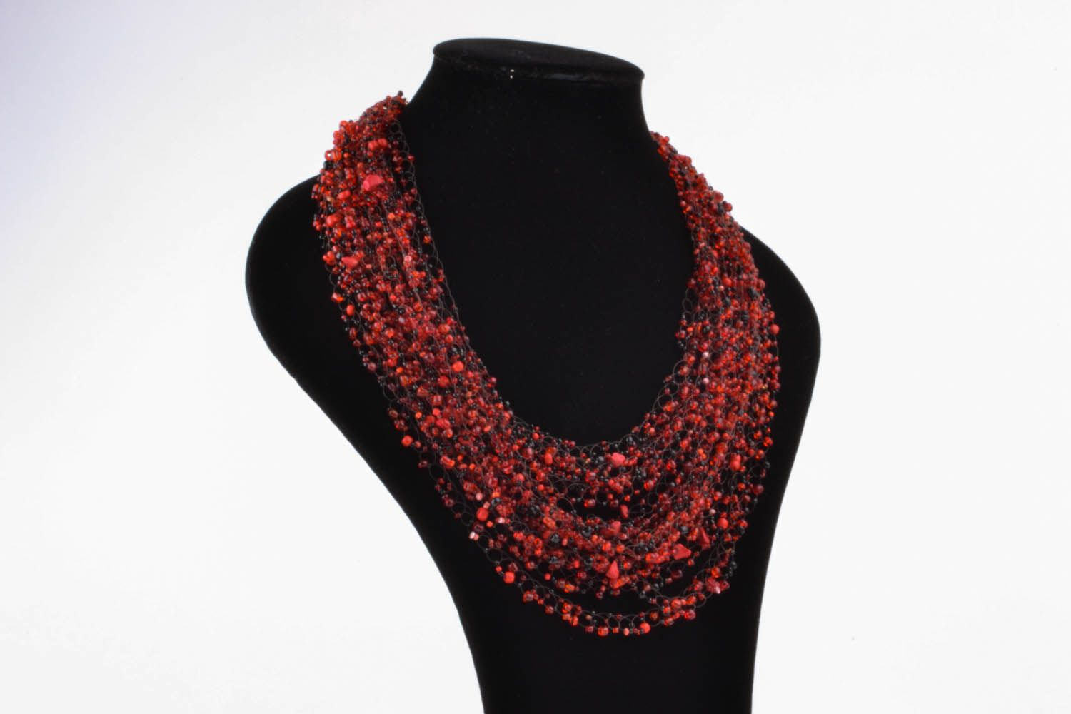 Red and black necklace made of beads and natural stones photo 1