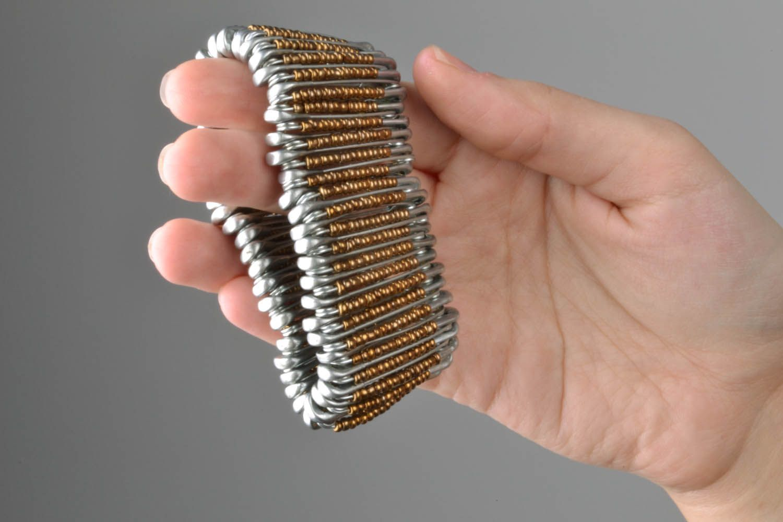 Woman's wrist bracelet made of pins photo 5