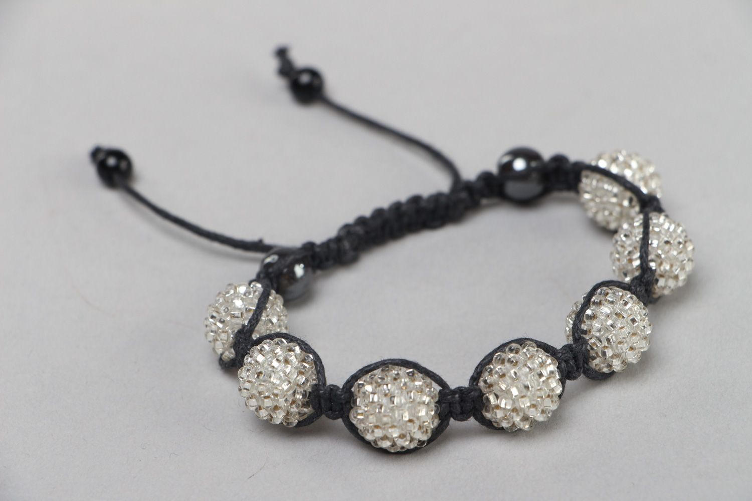 Handmade black and white friendship bracelet woven of waxed cord and beads  photo 1