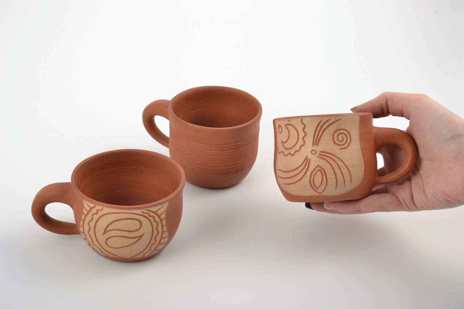 Set of handmade clay cups painted with mineral engobes 3 pieces home decor photo 2