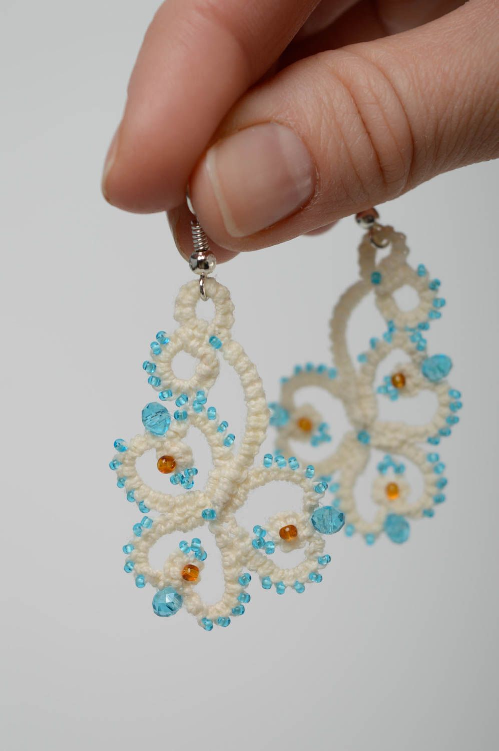 Festive woven earrings photo 4