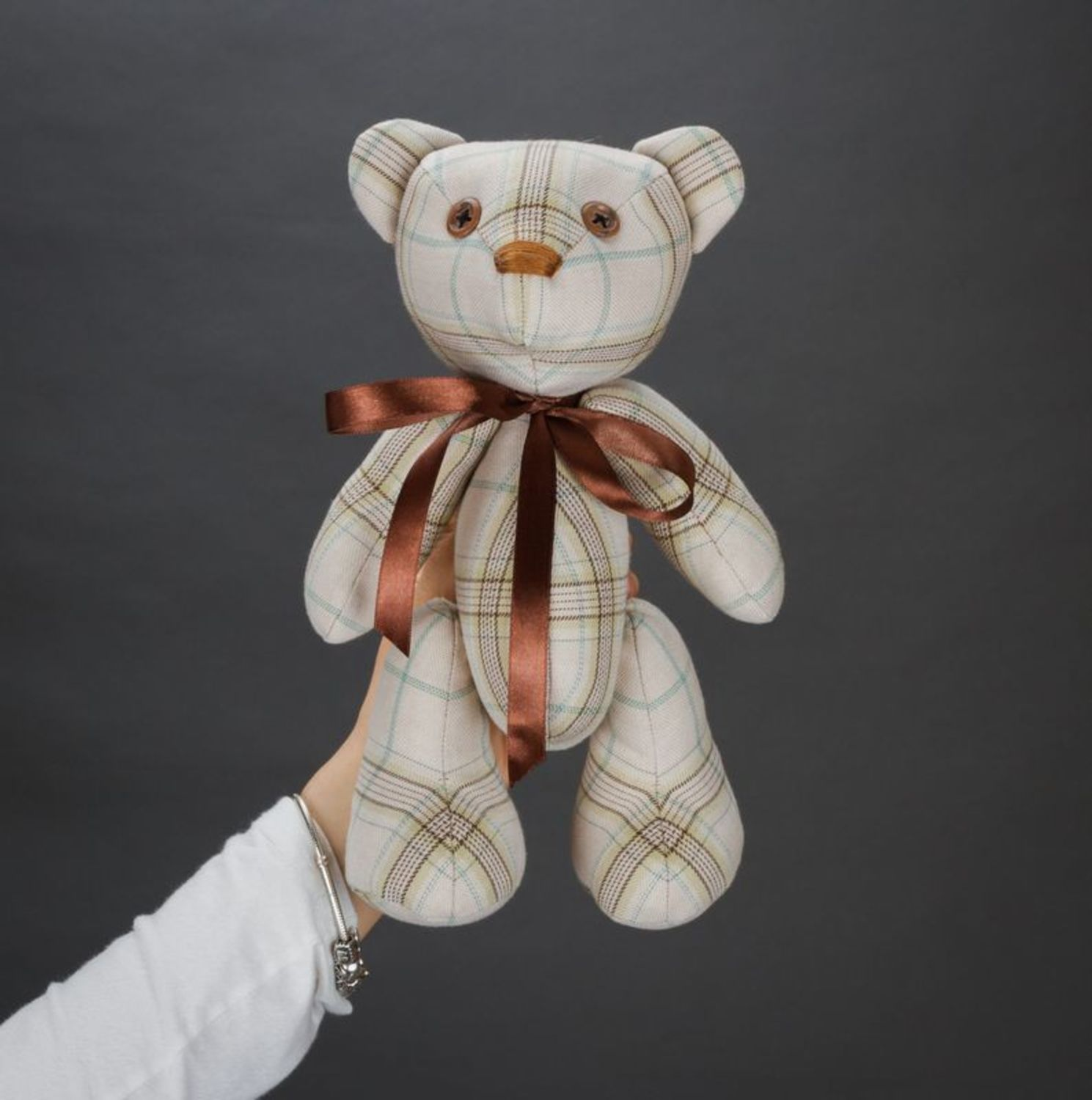 Soft children's toy bear with bow on neck and paws fixed on hinges photo 3