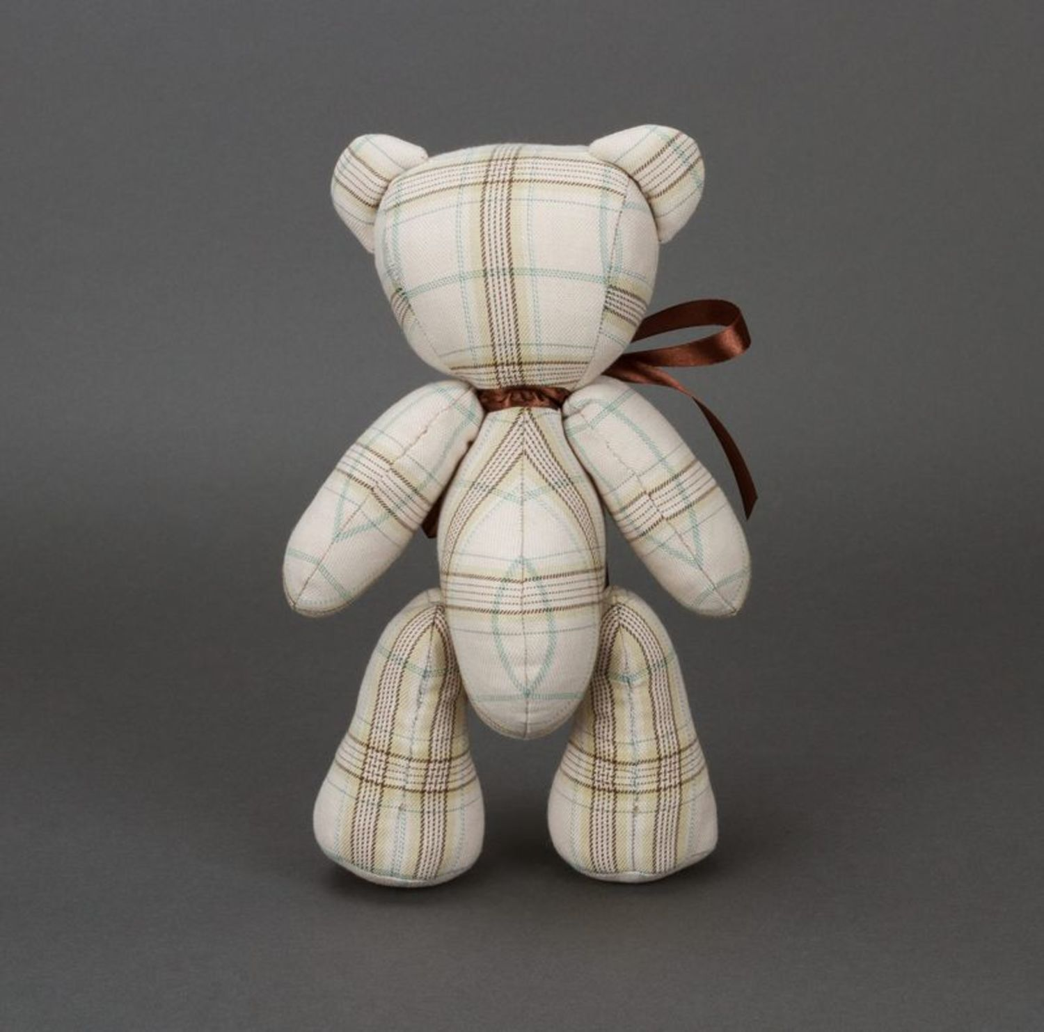 Soft children's toy bear with bow on neck and paws fixed on hinges photo 6