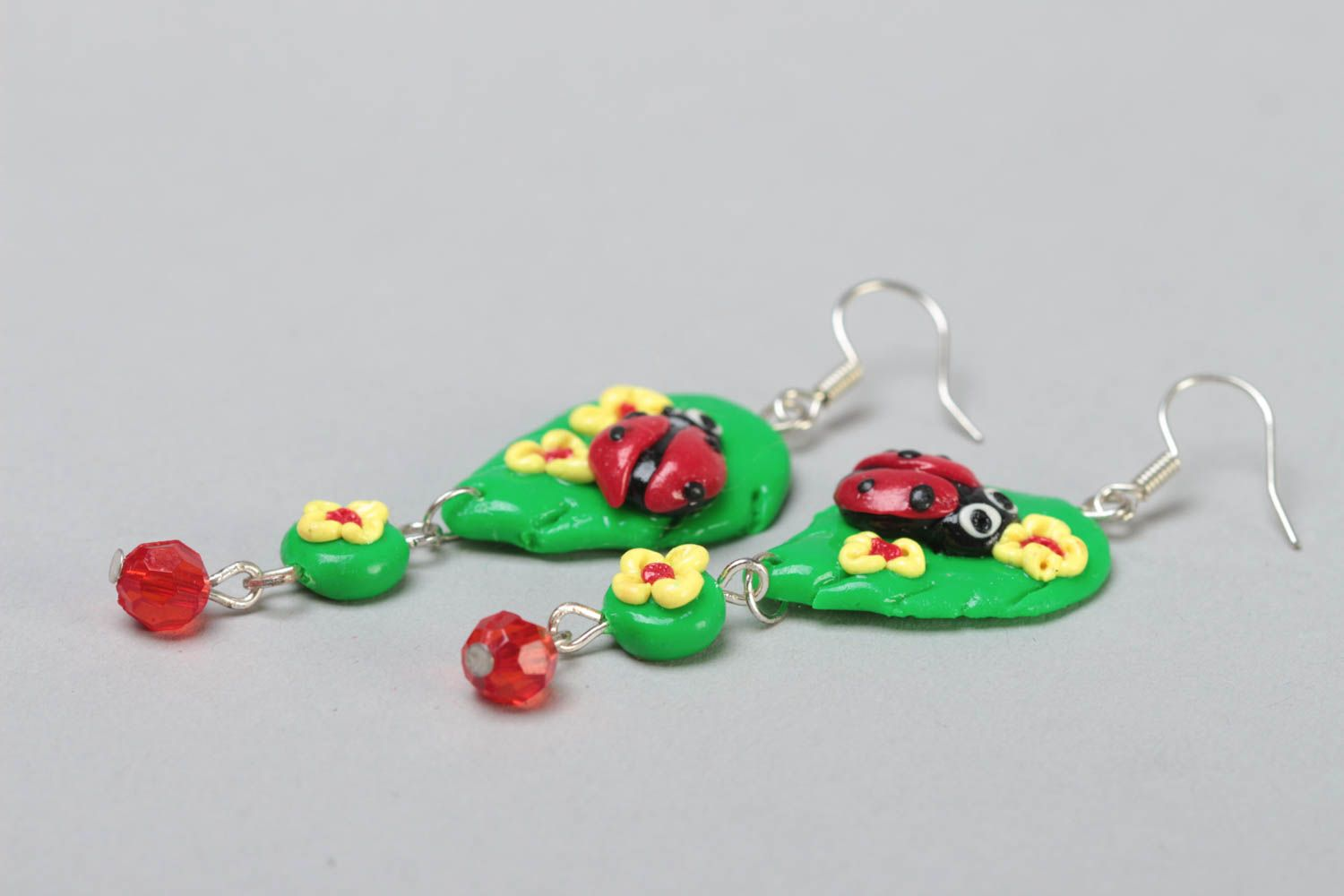 Handmade bright green long dangling polymer clay earrings with ladybugs photo 3