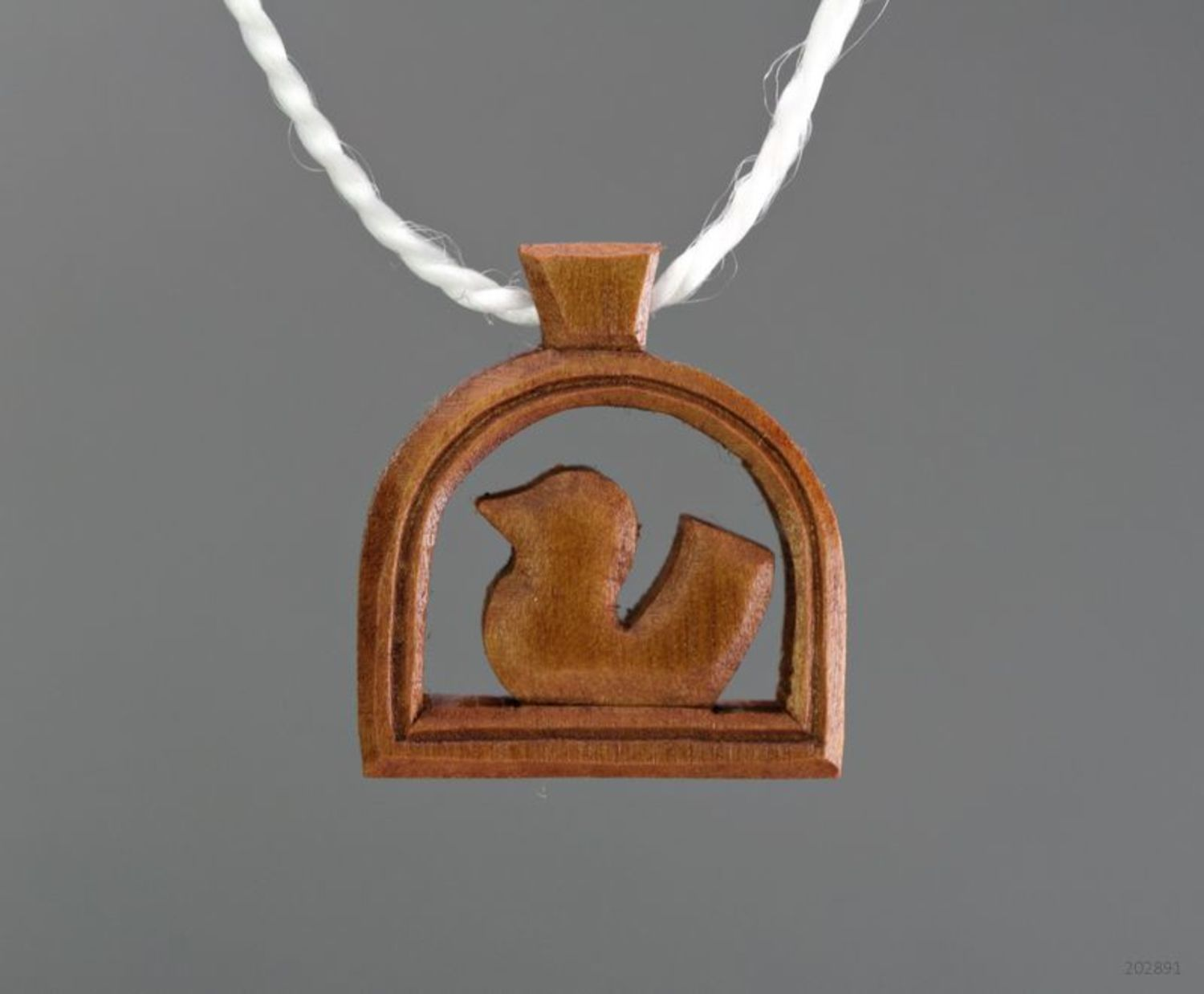 Wooden pendant in the shape of a bird photo 1