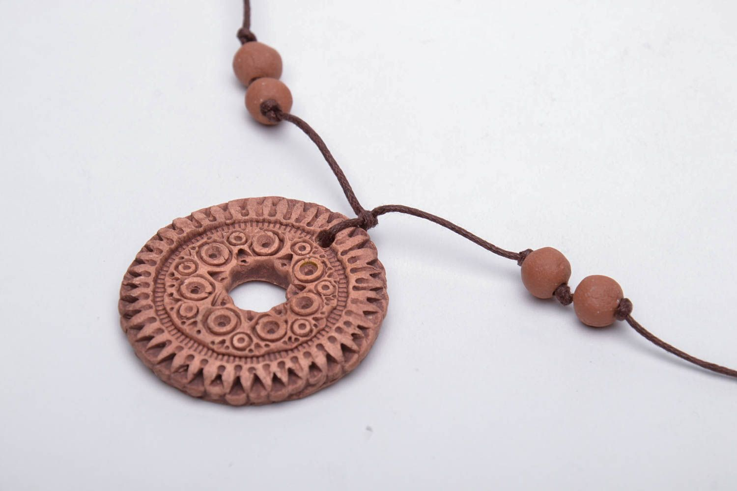 Brown clay pendant photo 4
