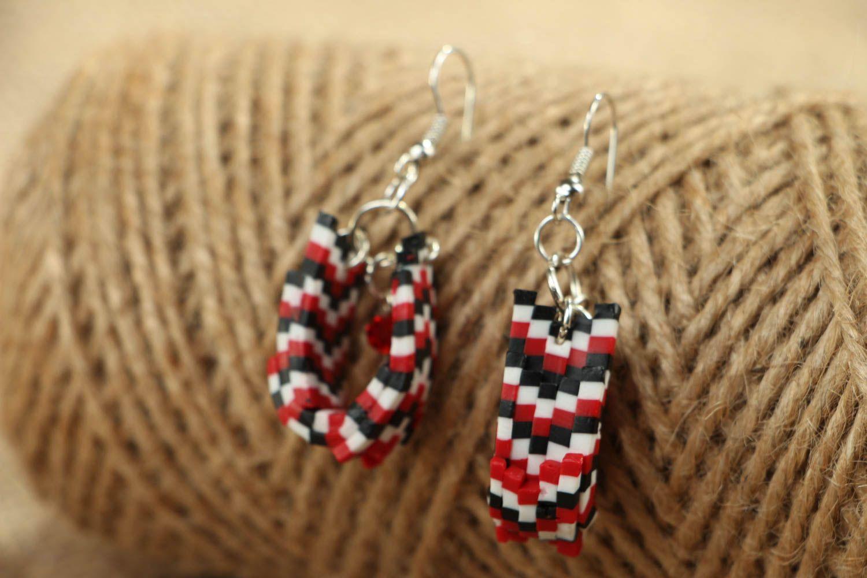 Stylish plastic earrings photo 4