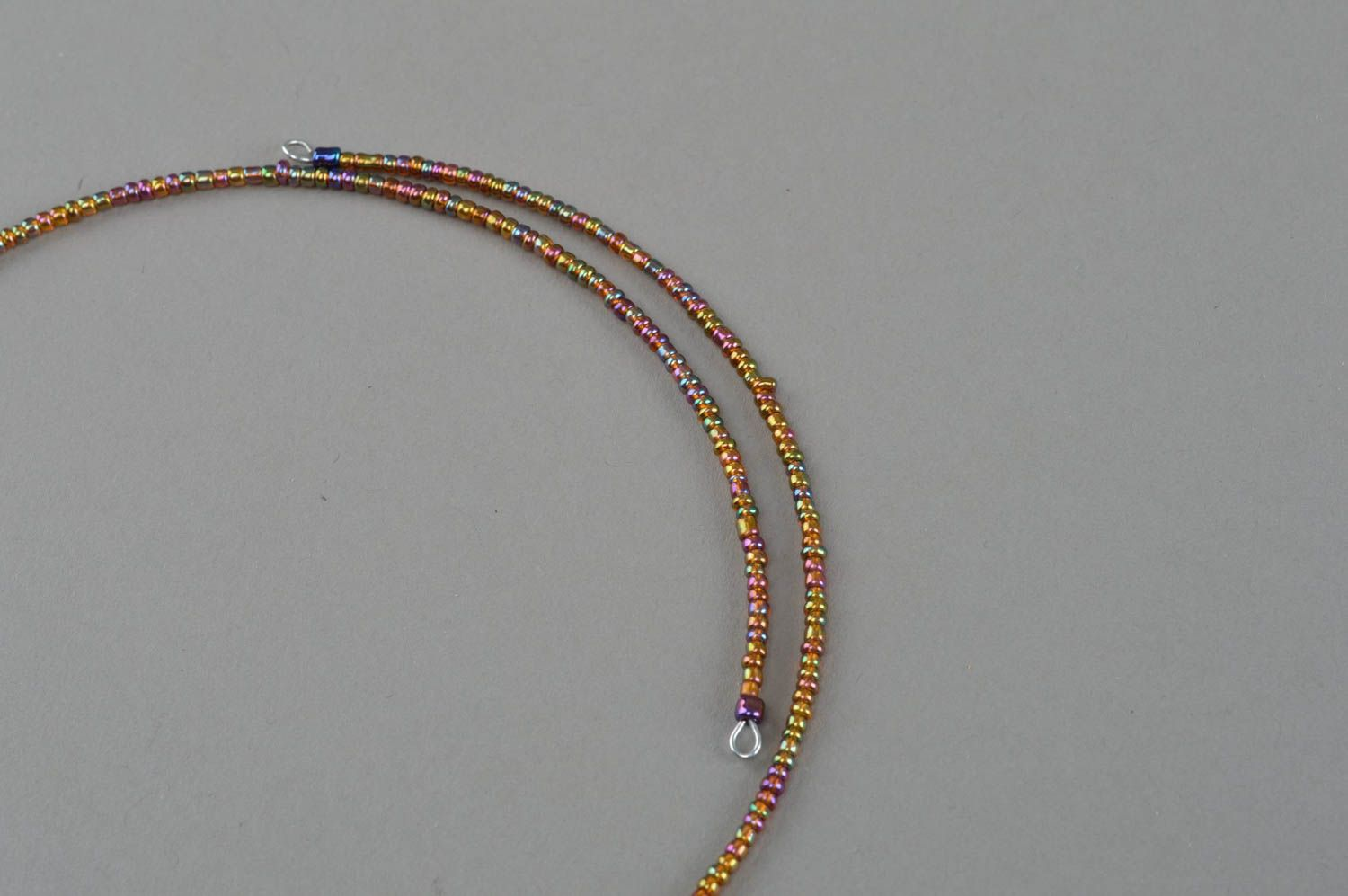 Handmade woven beaded thin necklace with stars on a fishing line photo 4