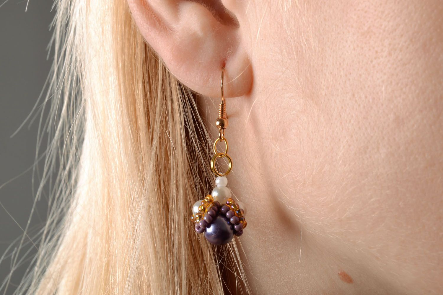 Beaded earrings with charms photo 5