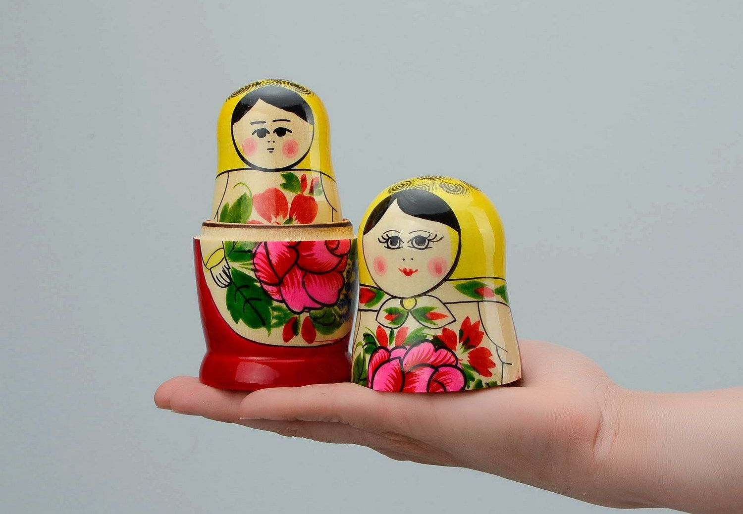 Painted wooden nesting doll of average size photo 5