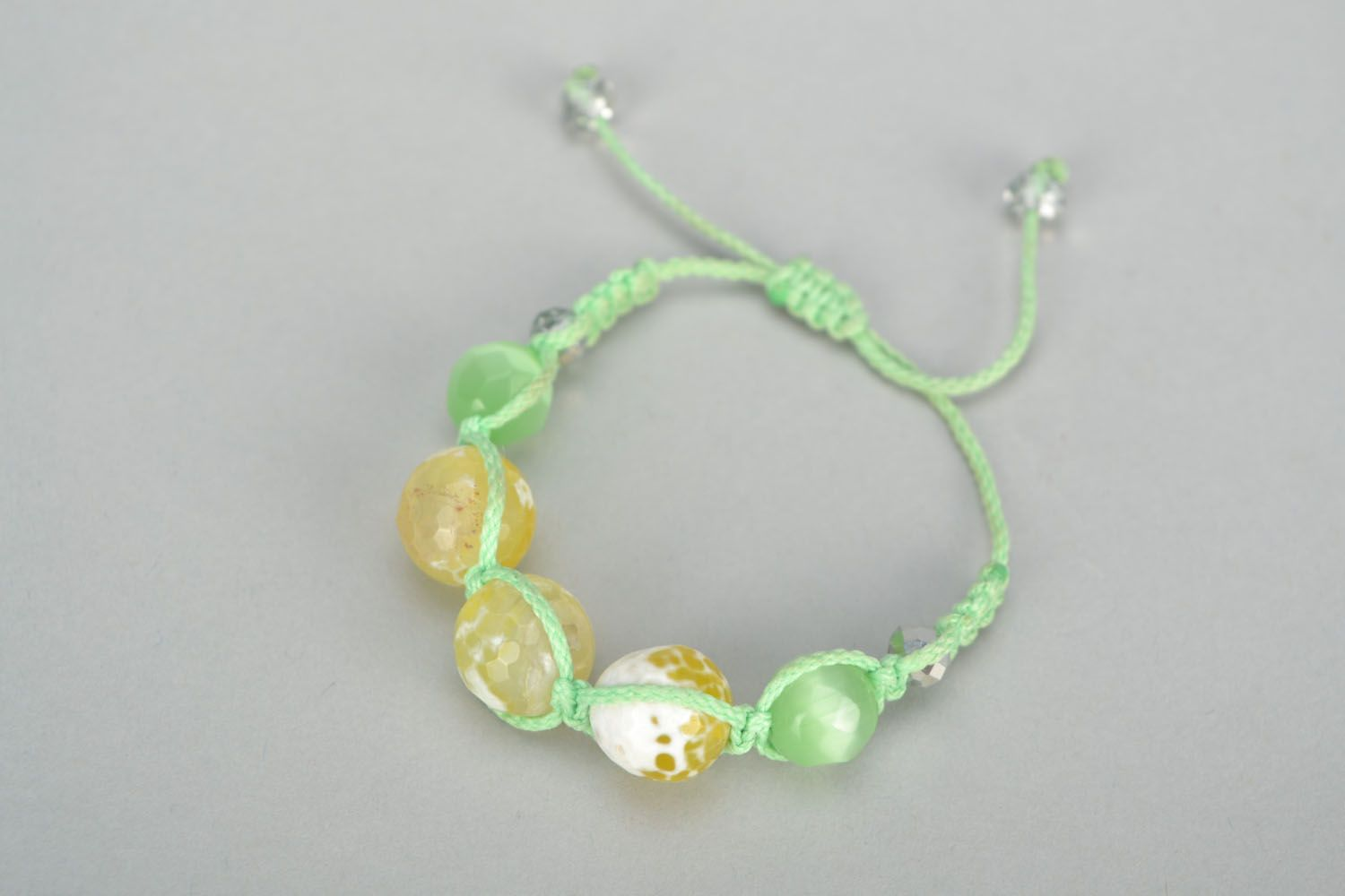 Woven bracelet with cat's eye stone photo 2