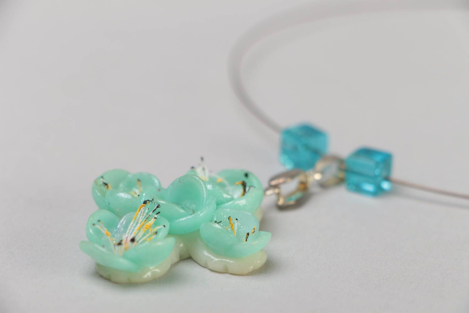 Handmade necklace on metal wire with polymer clay cross pendant of blue color photo 4