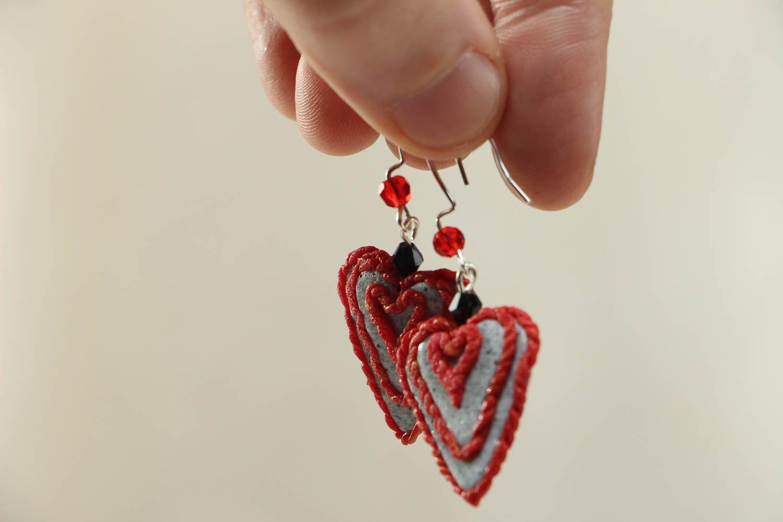 Heart-shaped plastic earrings photo 3