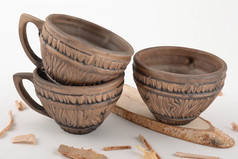 Set of 3 handmade designer ceramic tea cups molded of white clay 330 ml each