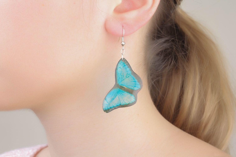 Schöne Ohrringe in Form von Schmetteringen foto 5