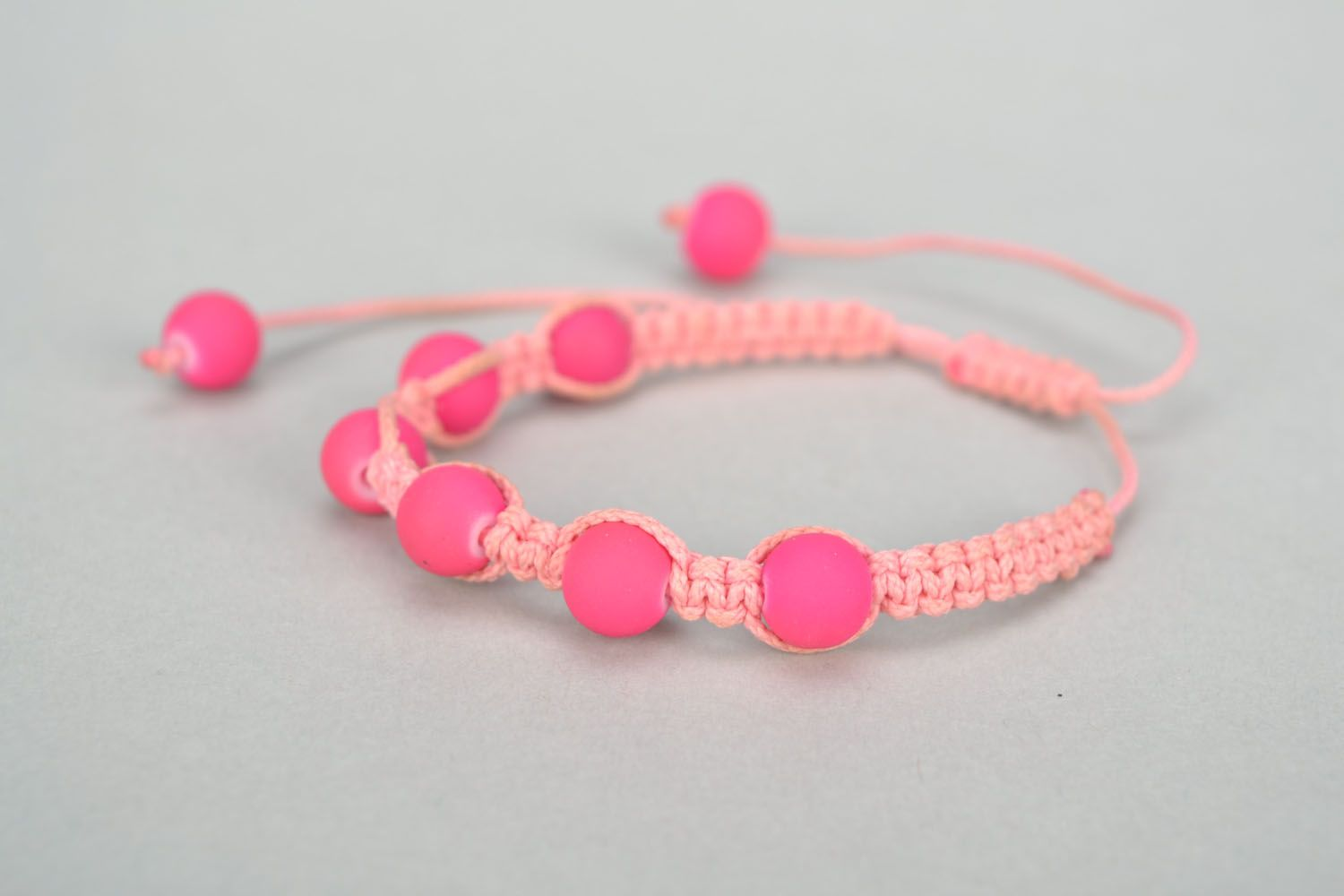 Woven bracelet with pink plastic beads photo 3