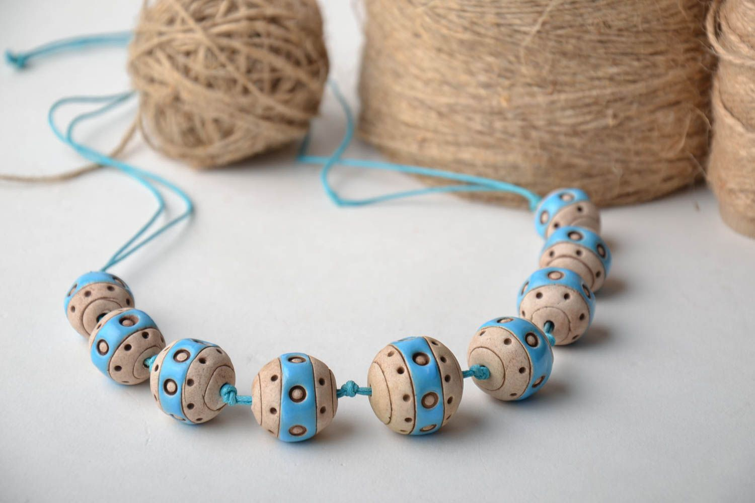Clay bead necklace with cord photo 1
