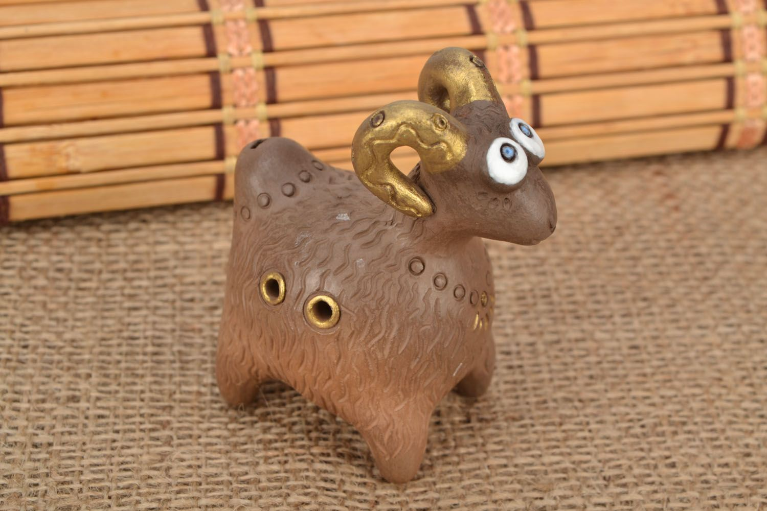 Clay penny whistle in the shape of ram photo 1